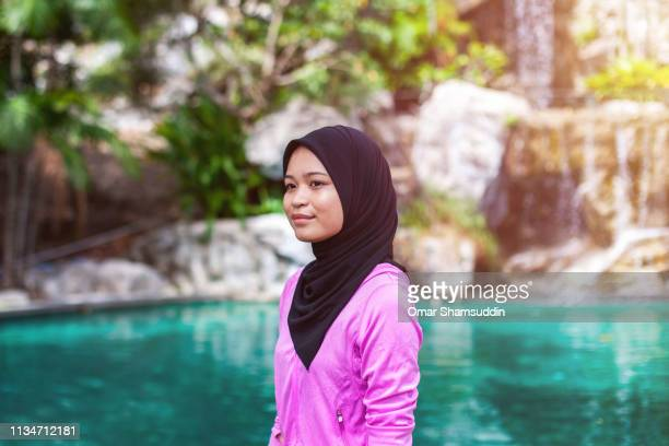 Portrait of sporty young Asian woman in hijab