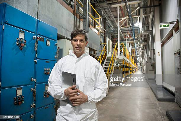 Portrait of spray shop worker in car factory
