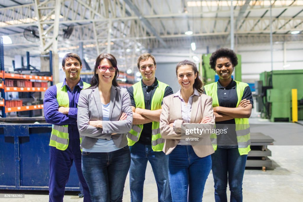 Portrait of staff at distribution warehouse : Stock Photo