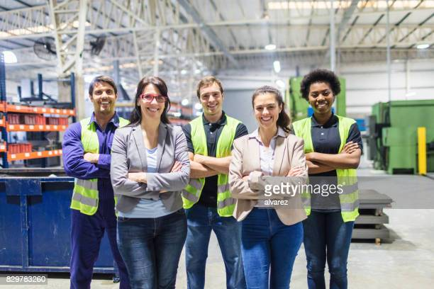 portrait of staff at distribution warehouse - employee stock pictures, royalty-free photos & images