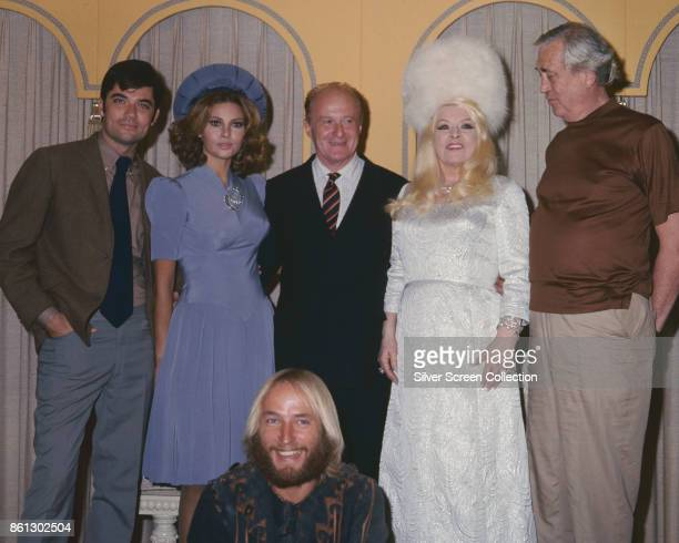 Portrait of, standing from left, American actor Rex Reed , actress Raquel Welch , producer Robert Fryer , actress Mae West , and actor John Huston ,...