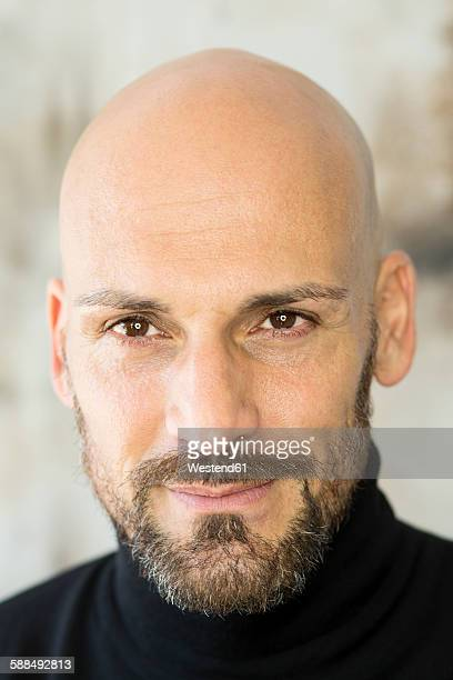 Portrait of staring man wearing black turtleneck