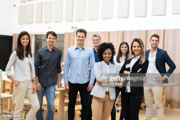 portrait of startup entrepreneurs with arms crossed - organized group stock pictures, royalty-free photos & images