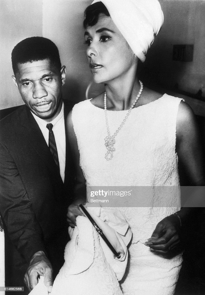 A portrait of State Field Representative Medgar Evers escorting singer Lena Horne to a civil right rally in Jackson, Mississippi.