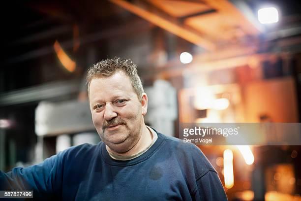 Portrait of steel worker in factory