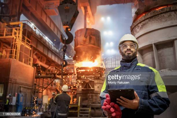 portrait of steelworker during steel pour in steelworks - safety stock pictures, royalty-free photos & images