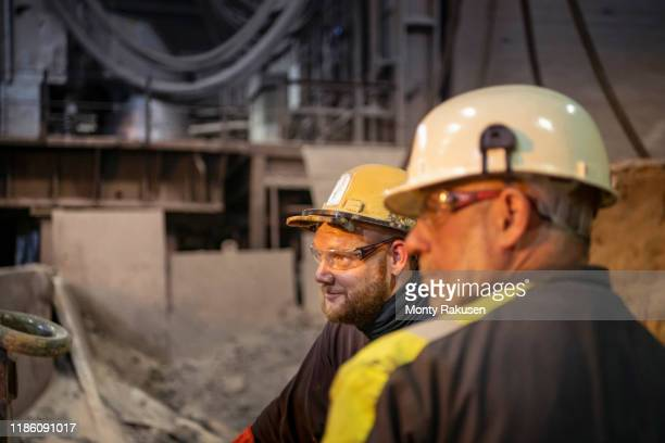 portrait of steelworkers in steelworks - collaboration stock pictures, royalty-free photos & images