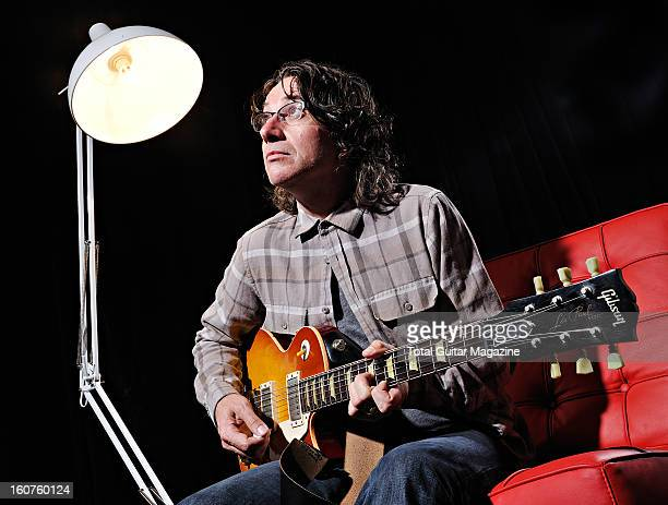 Portrait of Stone Gossard rhythm guitarist with American grunge rock group Pearl Jam before a performance at the Manchester Evening News Arena on...