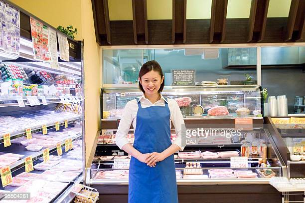 Portrait of store clerk at supermarket