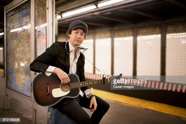portrait of street musician in subway - musician stock pictures, royalty-free photos & images