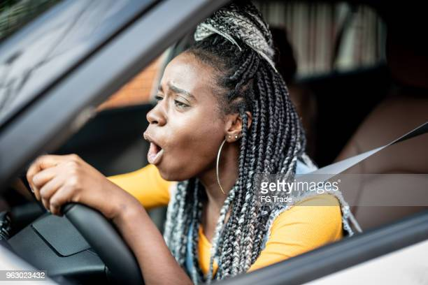 portrait of stressed african woman in car - insanity stock pictures, royalty-free photos & images