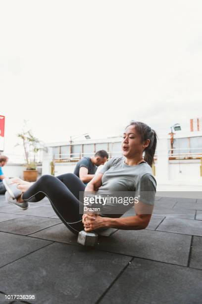 portrait of strong woman on cross training in kuala lumpur - circuit training stock photos and pictures