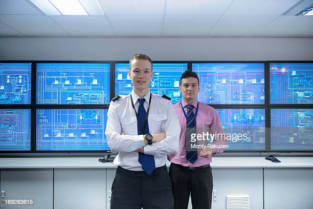 Portrait of student and tutor in ship's engine room simulator