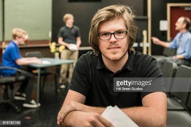 portrait of student holding script in theater class - acteur photos et images de collection