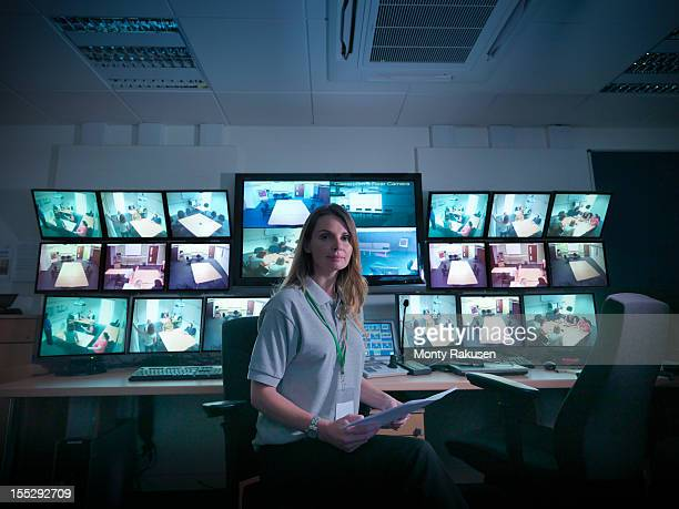 portrait of student with screens in forensics training facility - woman prison stock-fotos und bilder