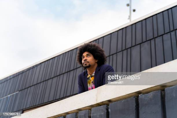 portrait of stylish man behind a wall - insurrection stock pictures, royalty-free photos & images