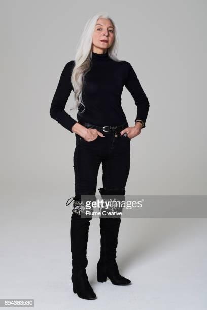 portrait of stylish mature woman - ブーツイン ストックフォトと画像