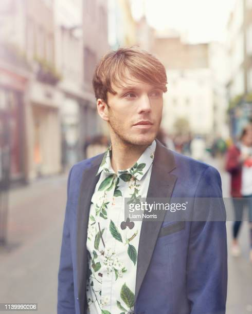 portrait of stylish mid adult man on street, london, uk - only mid adult men stock pictures, royalty-free photos & images