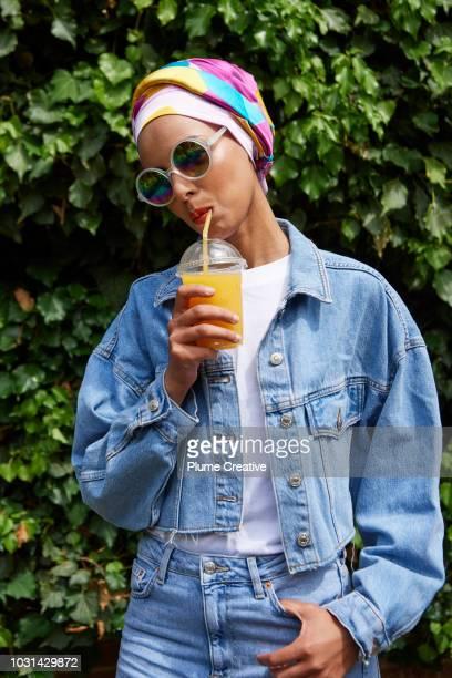 Portrait of stylish Muslim woman against lush foliage