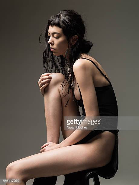 portrait of stylish woman sitting in studio