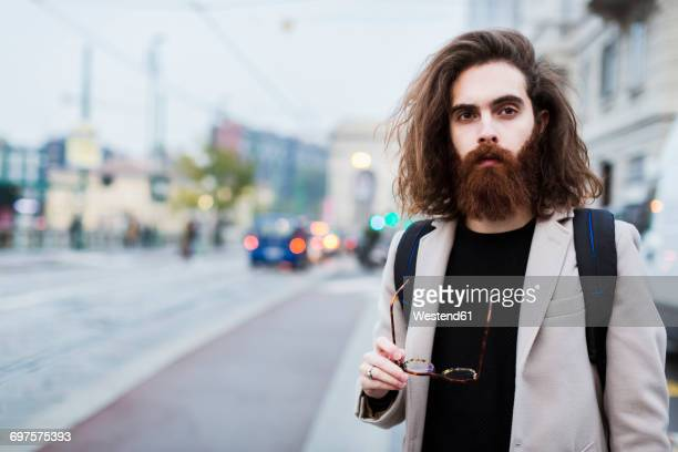 Portrait of stylish young man in the city