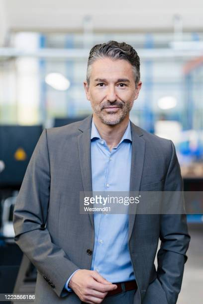 portrait of successful businessman in shop floor of company - vertical stock pictures, royalty-free photos & images