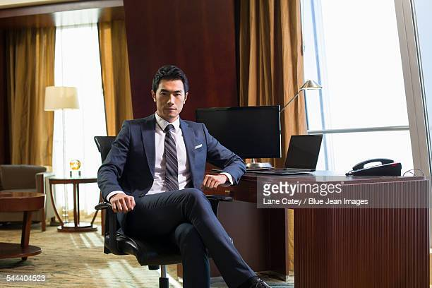 portrait of successful businessman in study - handsome chinese men stock pictures, royalty-free photos & images