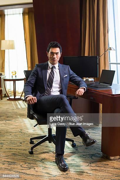 portrait of successful businessman in study - 足を組む ストックフォトと画像