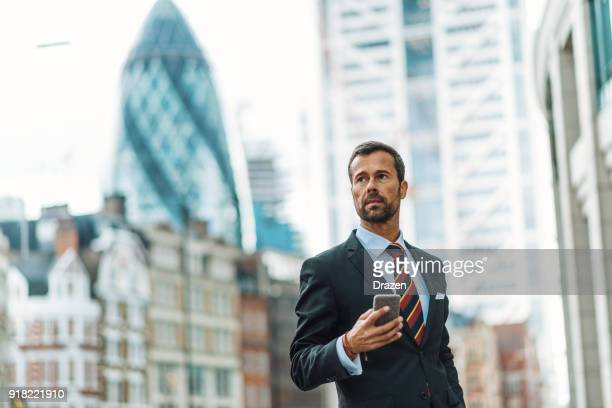 portrait of successful businessman in united kingdom - businessman foto e immagini stock