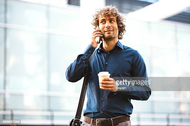 Portrait of successful businessman with smartphone