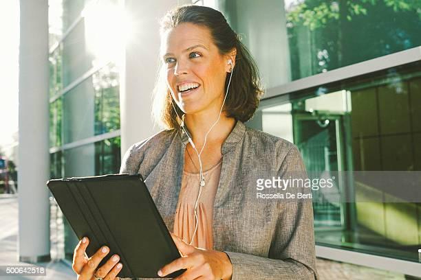 Portrait Of Successful Businesswoman Using Tablet In Urban Landscape