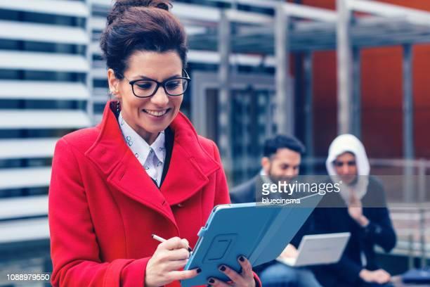 Portrait of successful businesswoman using tablet