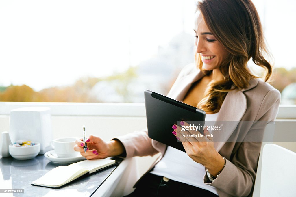 Portrait Of Successful Businesswoman Working  At Cafè : Stock Photo