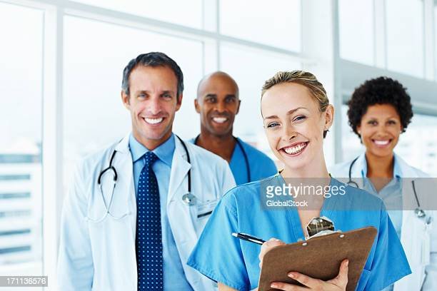 Portrait of successful doctors standing together