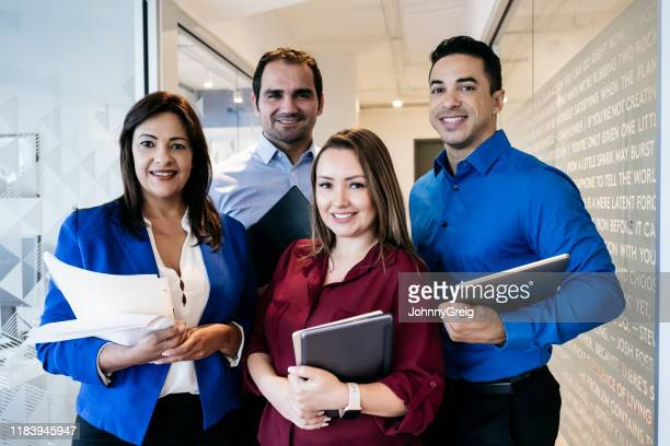 portrait of successful hispanic media content strategists - open collar stock pictures, royalty-free photos & images