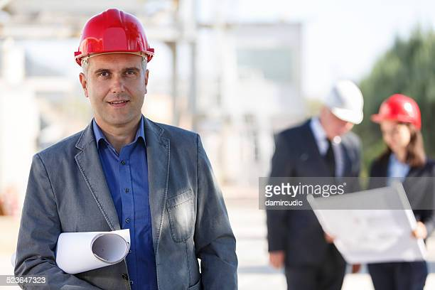 Portrait of successful male architect at a building site