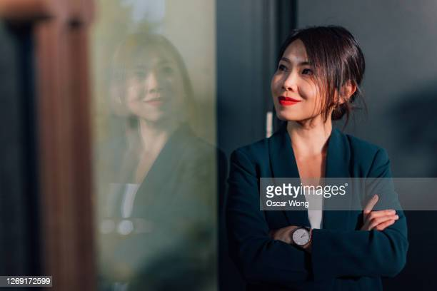 portrait of successful young asian businesswoman - portrait stock pictures, royalty-free photos & images