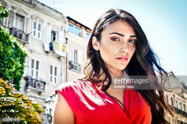 Portrait of sultry young woman on street, Cagliari, Sardinia, Italy