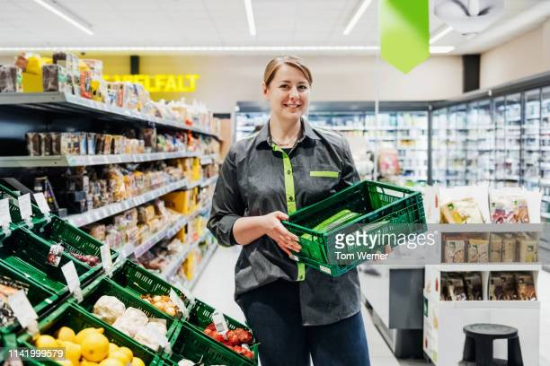 portrait of supermarket employee - produce aisle stock pictures, royalty-free photos & images