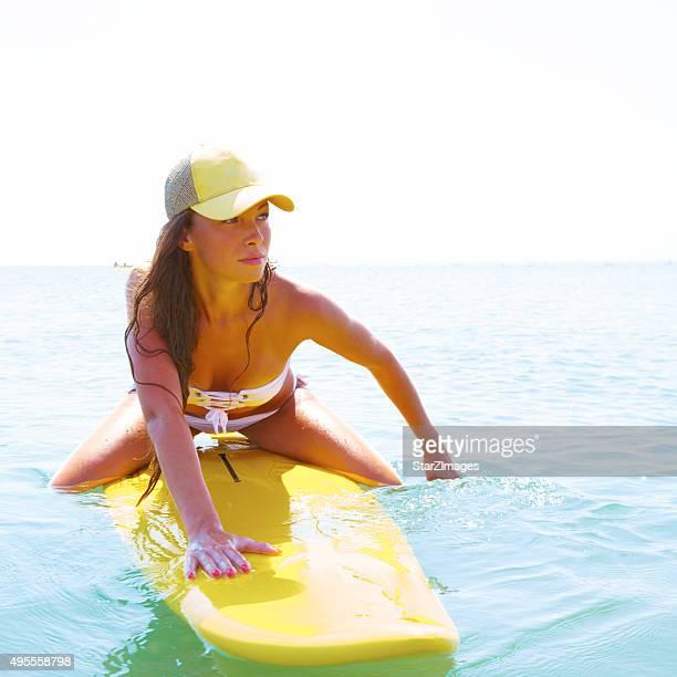 portrait of surf girl over ocean background