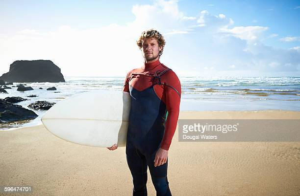 Portrait of surfer on beach.