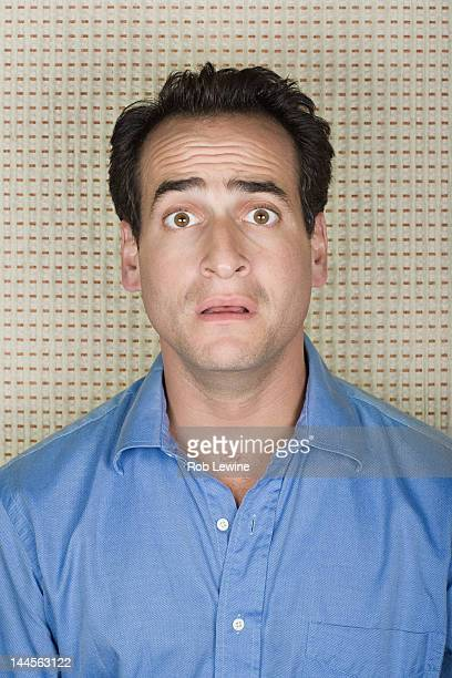 portrait of surprised man - distraught stock pictures, royalty-free photos & images