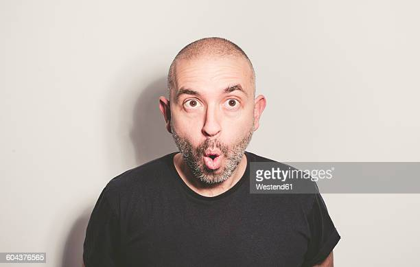 portrait of surprised man - surprise stock pictures, royalty-free photos & images