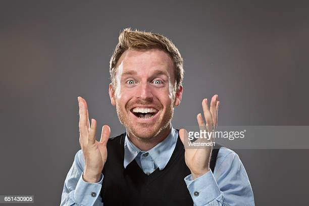portrait of surprised man - hysteria stock pictures, royalty-free photos & images