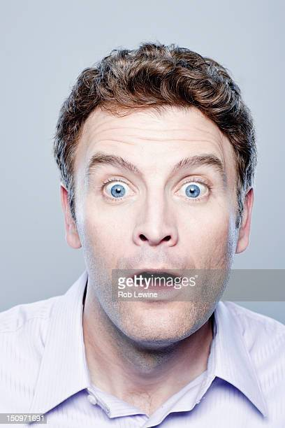 Portrait of surprised mid adult man, studio shot