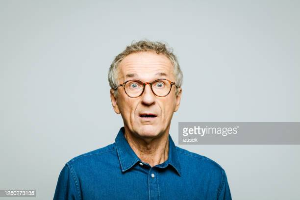 portrait of surprised senior man - terrified stock pictures, royalty-free photos & images