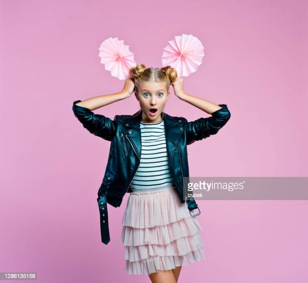 portrait of surprised teenege girl holding origami fans wheel - embellished jacket stock pictures, royalty-free photos & images