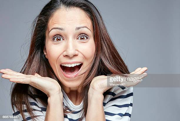 Portrait of surprised woman screaming out loud