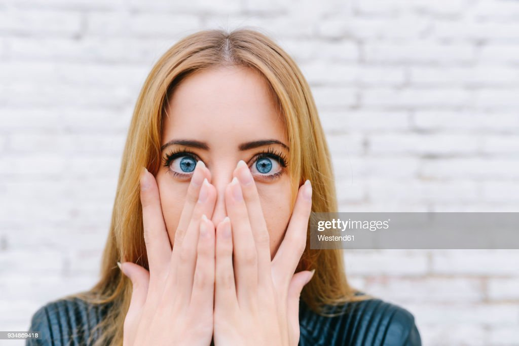 Portrait of surprised young woman : Stock Photo