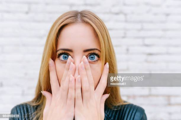 portrait of surprised young woman - fear stock pictures, royalty-free photos & images